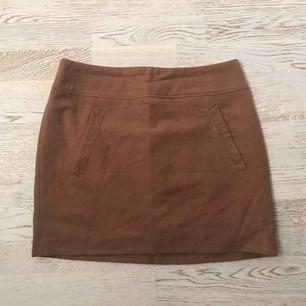 Brun lite tjockare kjol från , aldrig använd pga fel storlek