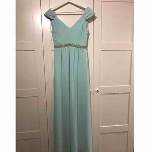 Ljus blå/turkos balklänning, fint skick. 300+frakt