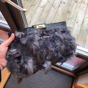 Snygg handväska fauxfur från asos, väl använd