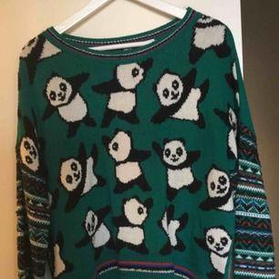 En fin grön stickad tröja från Urban Outfitters.