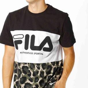 En cool fila-t-shirt, helt ny. En XS, passer til S. 120kr inkl.
