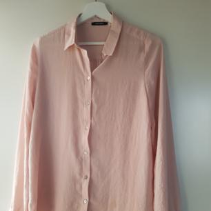 Skjorta ljusrosa storlek M