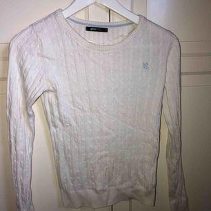Kabelstickad tröja från Gina Tricot.