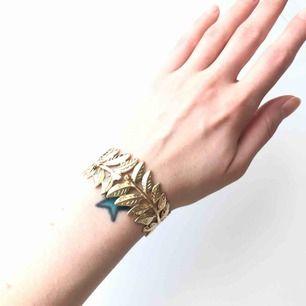 jättefint armband med Gren/blad, oanvänt. Upphämtning eller +frakt 18kr.