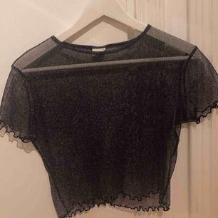 Fin glittrig mesh tröja