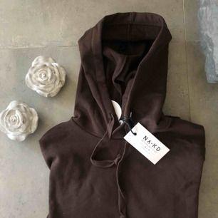 En supermysig brun hoodie från NAKD! Aldrig använd! Köparen står för frakt ☀️