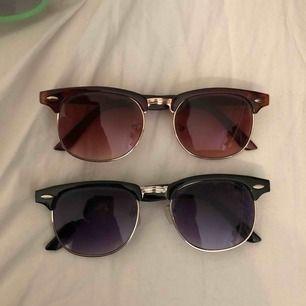 Bruna och svarta Solglasögon