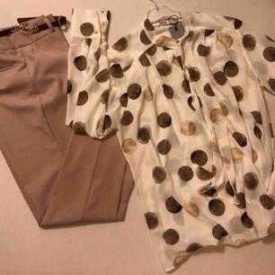 Helt nya  Dam skjorta kostar 299kr Byxa kostar 399 kr  Båda för 600kr missa inte!