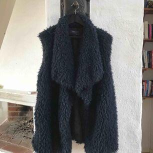 Mjuk kappa i västmodell från Zara i Barcelona.