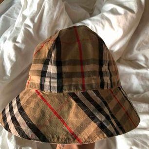 Burberry bucket hat.