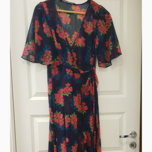 Zara Maxi wrap dress - Sheer floral print that ties in the front, can be adjusted after desired fit.