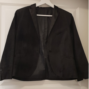 Jacket from Whyred, waist long with 3/4 sleeves in black manchester fabric with silk collar