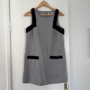 This is a 60's style check dress from River Island, Chelsea Girl. It is bought second hand, in good condition. I'm selling because it's too small for me. I would say it's pretty true to size.