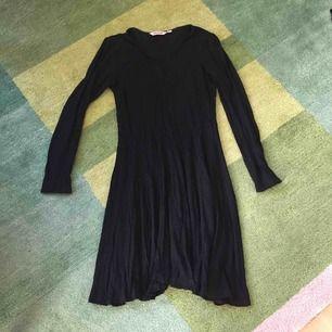 Snygg utsvängd klänning från Indiska