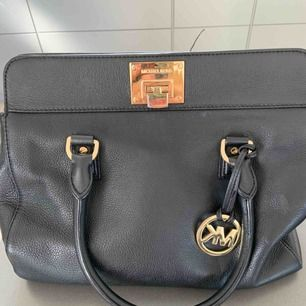 Real MK satchel PLUS matching wallet OBS! Can also be purchased individually! Brand: Michael Kors Colour: Black  Purchased 2 years ago.  Bag has several inside pockets + a long strap that can be added. Wallet has room for 14 credit cards, coins and bills.