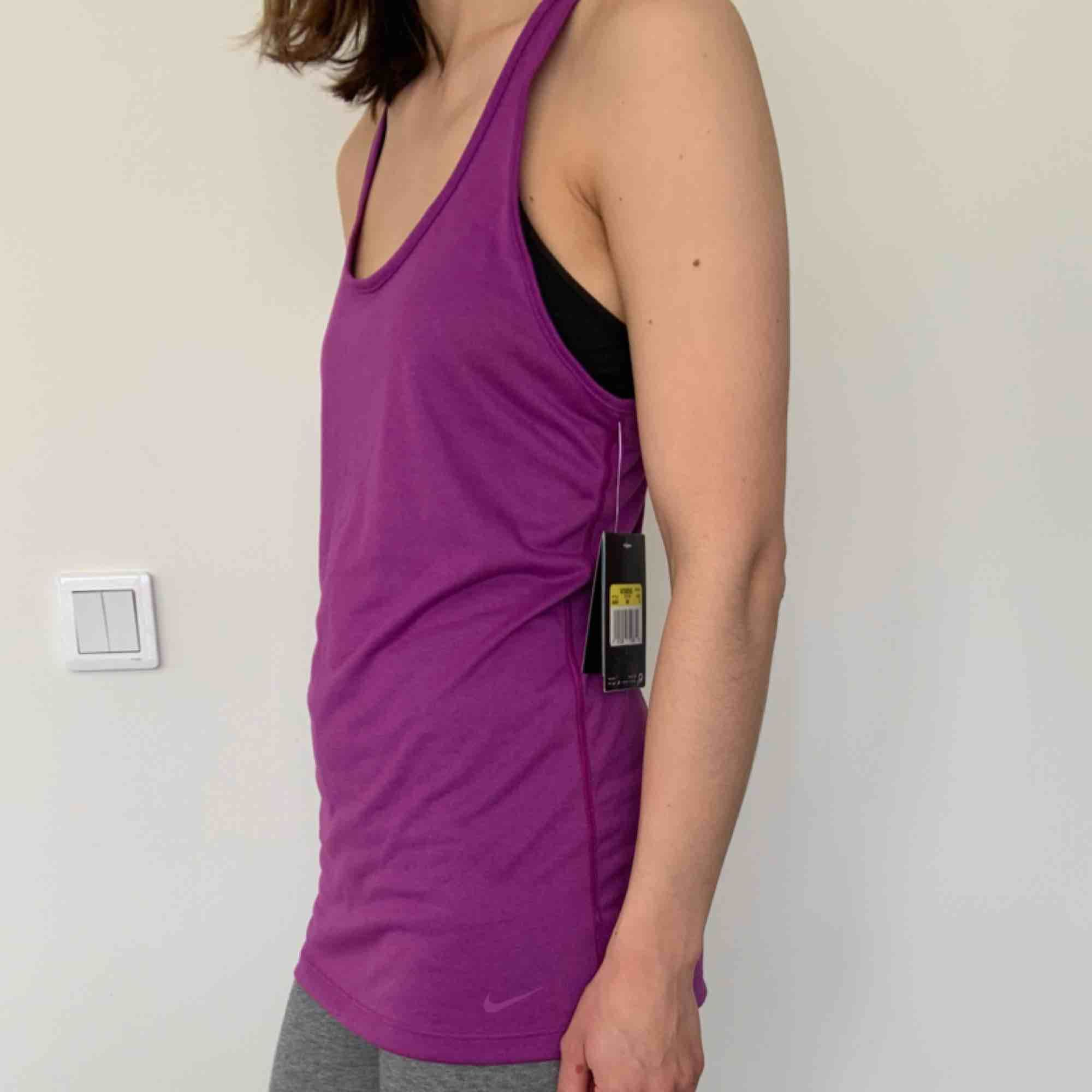 Nike Dry Fit tank top Brand: Nike Size: S Colour: Purple  Never worn. Still has tag. 2 years old.. Toppar.