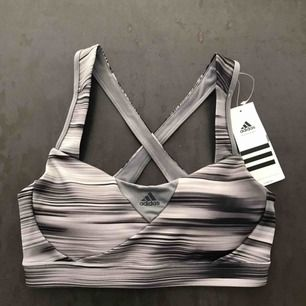 Brand new sport bra from Adidas. Ordered online, unfortunately too small for me. Price can be discussed.