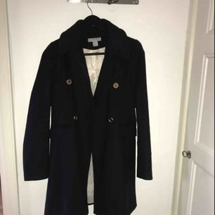 Knee length navy blue jacket