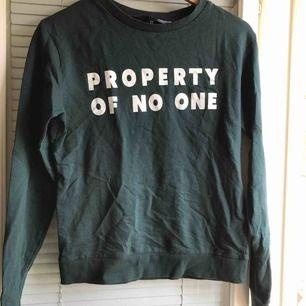Mörkgrön tröja från H&M.