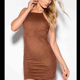 Skitsnygg Rebecca Stella klänning storlek S knappt använd.