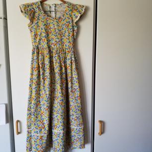 Jättefin vintage  långklänning med dragkedja i ryggen