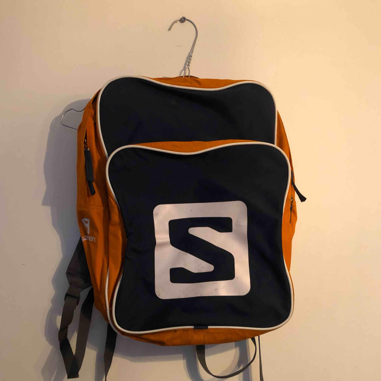 Salomon ryggsäck. Väskor.
