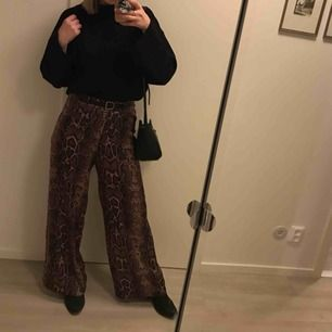 Nice loose pants with snake pattern. Used once.