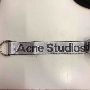 Acne straps, originally used for hanging scarves , but they work as  belts and strap fanny packs too . 123 cm.