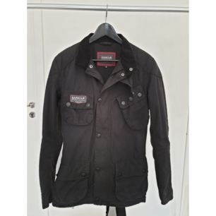 Men's slim fit Barbour International Triumph limited edition wax jacket, size M. Color is black. Used max 10 times. Like new.