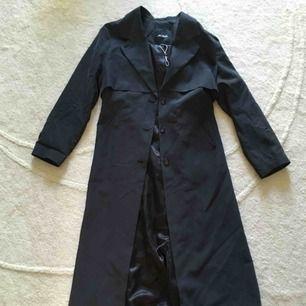 Kappa från Monki storlek S  Tyg: 70% Modal 30% polyester
