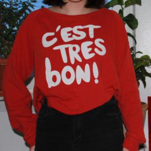 A sweatshirt saying C'EST TRES BON! (