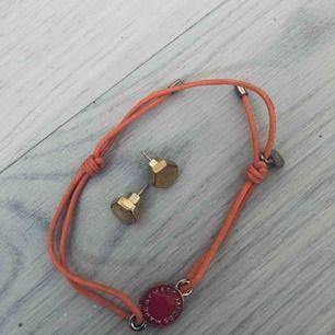 Armband + örhängen från Marc Jacob's i guld.