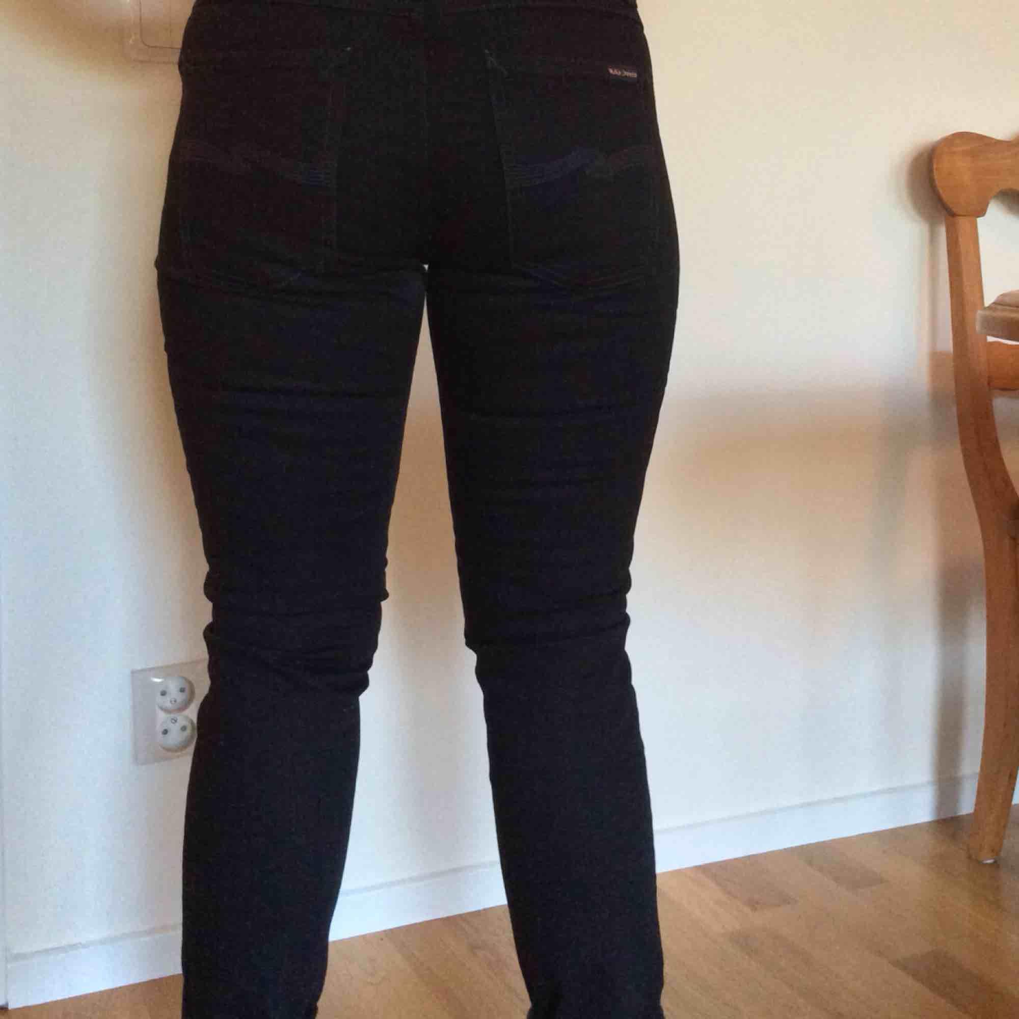Ett par ekologiska helt oanvända jeans från nudie jeans co. . Jeans & Byxor.