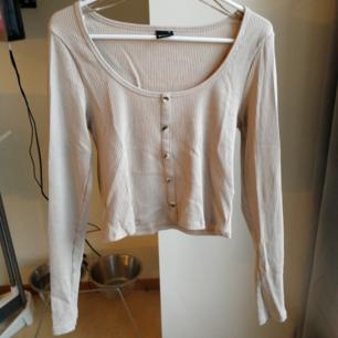 Beige tröja