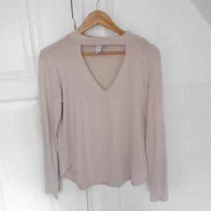 Urringat tröja i vit/ljusrosa