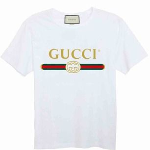 Gucci T-Shirt  Fabric: 100 Percent Cotton   Color: White   Sleeve: Half Sleeve   Pattern: Printed   . Neck Shape: Round   . Fit: Regular Fit
