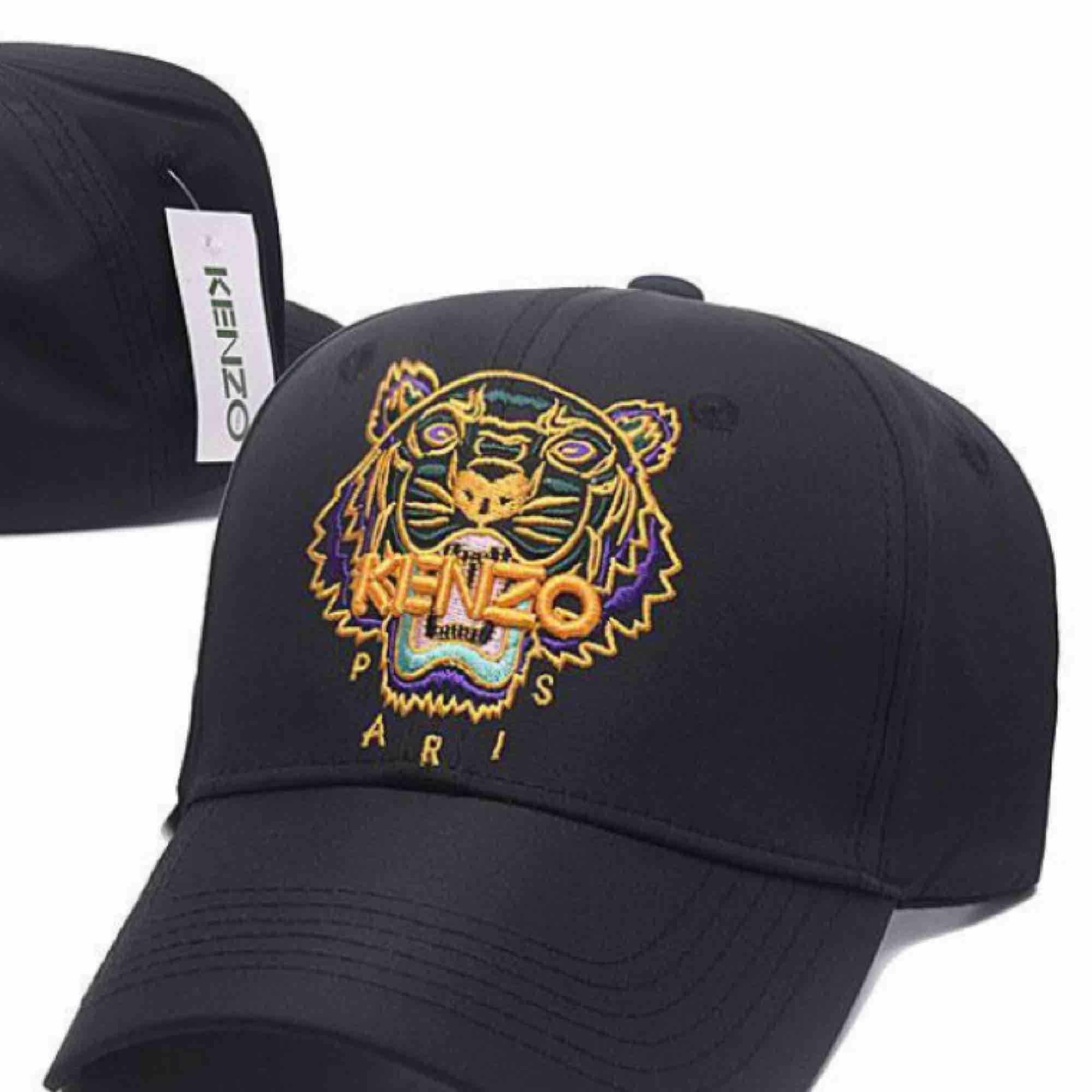 Tiger cap sportswear.  Tiger in neon colours and tube embroidery, Brings colour to any outfit.  KENZO logo.  Adjustable Velcro strap.. Accessoarer.