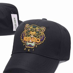 Tiger cap sportswear.  Tiger in neon colours and tube embroidery, Brings colour to any outfit.  KENZO logo.  Adjustable Velcro strap.