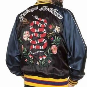 Men's black and multicolor Gucci floral-embroidered satin bomber jacket  Details Width: 45cm Shoulder: 16cm Length: 67cm Sleeve: 58cm  Country of Origin: Italy