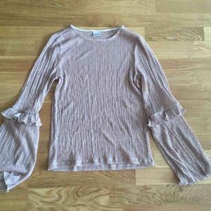 Glittrig tröja från Gina