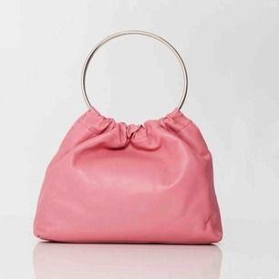 Supersnygg rosa väska från märket Little Liffner. Nästintill oanvänd!