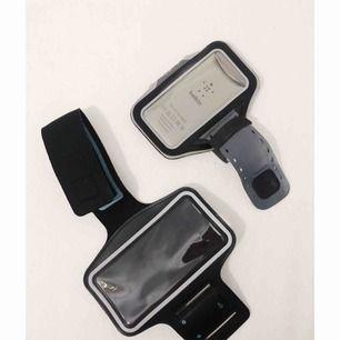 Sportarmband, mobilhållare. Övre passar iPhone 5/5S/5C, undre är såld.