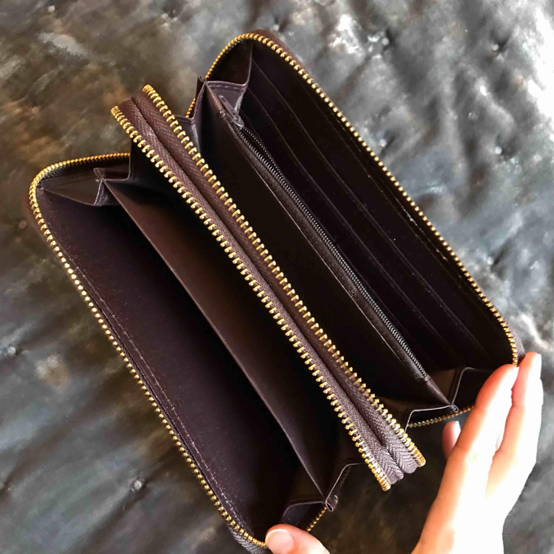 Ny plånbok 99kr  Kan fraktas mot kostnad . Väskor.