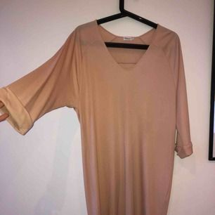 Filippa K nude, beige oversized dress with flare sleeves, comes down to  knees