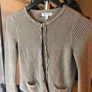 Jennifer Lopez Cardigan Used once with good condition Size: medium Color: light brownish grey w/ silver