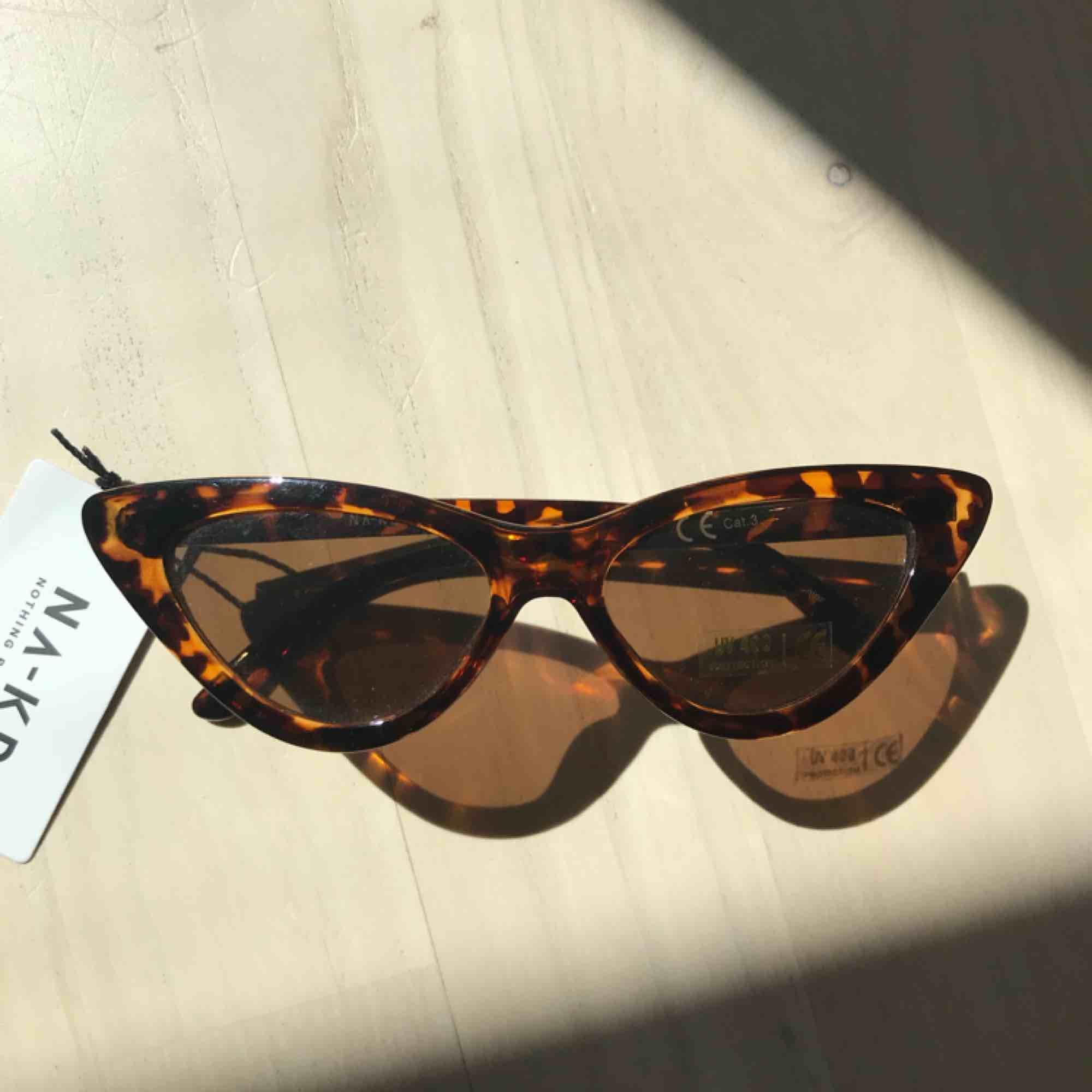 Nya cateye solglasögon från NAKD. Frakt tillkommer på 18kr. Accessoarer.