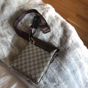 En Gucci väska som ör aldrig använd, kommer inte heller att använda den