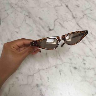 Solglasögon, oanvända