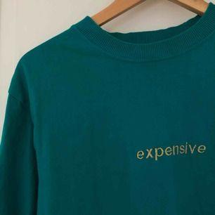 Blå tröja med tryck Köparen står för frakt