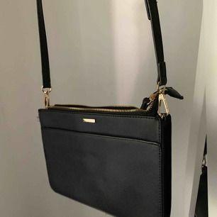 Väska med ett justerbart band